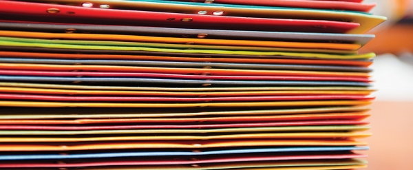 Spines of different coloured folders