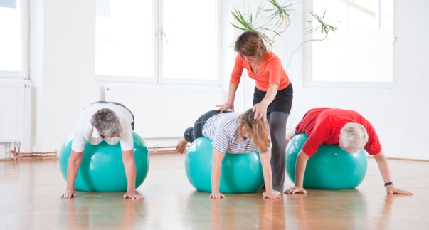 Three older people balancing on exercise balls