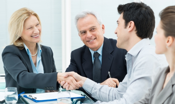 Successful Business Executives Shaking Hands With Each Other (woman and man)